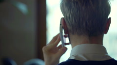 Businessman standing back and having a conversation on cellphone Stock Footage