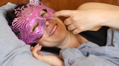 Seductive woman with a mask inviting to bed Stock Footage