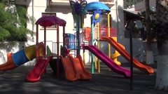 Children playground and one child Stock Footage