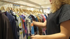 Shopping at Garments Apparel Clothing Shop - stock footage