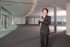 Businesswoman using a handheld computer Stock Photos
