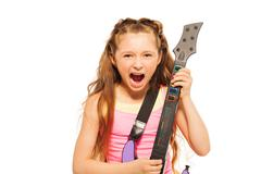 Portrait of excited girl playing on electro guitar Stock Photos