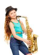 Cute happy girl playing alto saxophone alone - stock photo