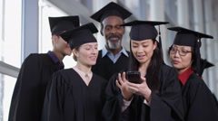 4K Happy group of mature students on graduation day pose for selfie with phone Stock Footage
