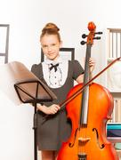 Girl with violoncello, string and musical notes - stock photo
