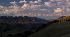 Time lapse clouds soaring over desert peaks at sunset, Hells Canyon Stock Footage