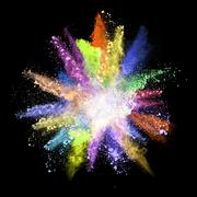 Explosion of colored powder on black background Stock Photos