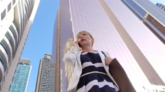 Woman has lost in the big city - stock footage