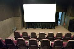 Empty stage in the small movie theater Stock Photos