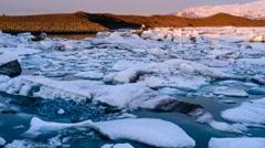 Icebergs melting in glacier lagoon timelapse Stock Footage