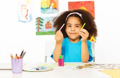 African girl holds cuisenaire rods learn to count Stock Photos