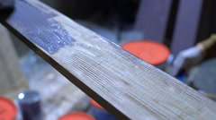 Wood texture and paintbrush. housework background - stock footage
