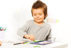 Boy putting coins as motivation to exercise Stock Photos