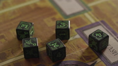 Board game dices on the game board close-up Stock Footage