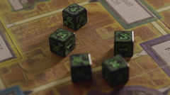 Five dices on the game board close-up Stock Footage