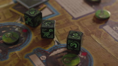 Roll three dice on the game board in the game Stock Footage