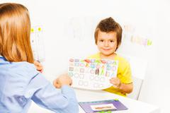 Cute boy holding the drawing with colored shapes Stock Photos
