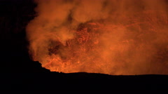 burning, glowing lava lake - Kilauea volcano crater  - stock footage