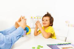 Smiling boy exercises improving motor skills - stock photo