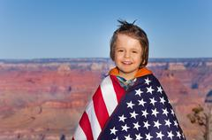 Boy with American flag, Grand Canyon National Park - stock photo