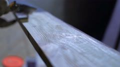 Paint brush on wood board, brush with lilac coating color - stock footage