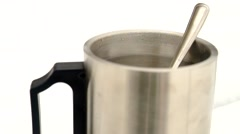 Hands preparing hot drink in thermal cup from thermos in a winter park Stock Footage