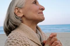 Senior woman looking spiritual Kuvituskuvat