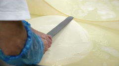 Cheese maker in a facrory Stock Footage