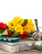 fishing tackles with bouquet spring flowers - stock photo
