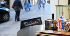 Street scene by a Maltese coffee shop in a Valletta side street Stock Footage