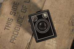 Historical camera on a wooden box - stock photo