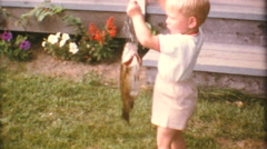 Boy Proudly Displays His Catch Of Fish-1967 Vintage 8mm film Stock Footage