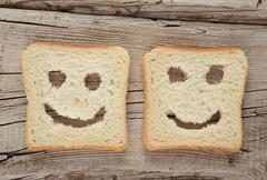 Happy toast on an old wooden - stock photo