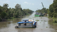 Barge sailing through Mekong Delta, natural waterway, transportation, Vietnam Stock Footage