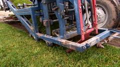 Machine cutting grass turf. - stock footage