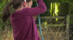 Little Girl On A Rope Swing In Slow Motion Stock Footage