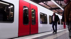 Train arrive at subway station platform, doors open, passengers go inside Stock Footage
