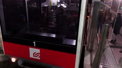 Passengers stand inside Vallvidrera Funicular, doors blocked for a while - stock footage