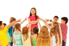 Confidence in audience kids point finger at girl - stock photo