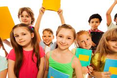 Cute funny group portrait of school kids Stock Photos