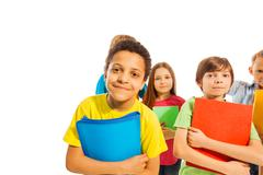 Funny African American school boy with friends - stock photo