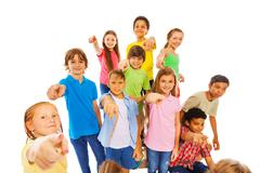 Large group of cute kids pointing at camera Stock Photos