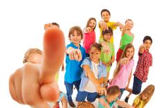 Funny group of kids pointing fingers Stock Photos