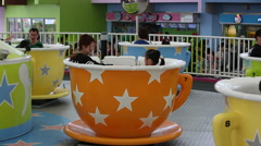 People in Spinning Tea Cups, Taipei Children's Amusement Park Stock Footage