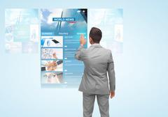 man with virtual projection of business news - stock photo