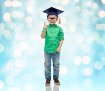 happy boy in bachelor hat and eyeglasses - stock photo