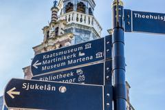 Tourist sign in front of the town hall in Franeker Stock Photos