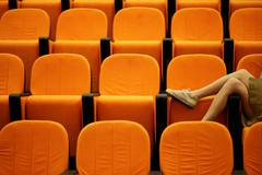 Woman's legs in a lecture theatre - stock photo