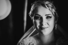Black white  photography portrait of bride on the classic dark background Stock Photos