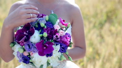 Bride holding her wedding bouquet in slow motion - stock footage